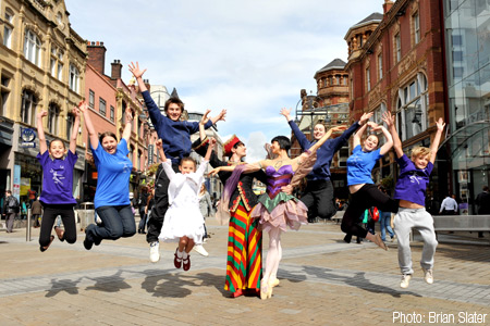 Anna Blackwell and Guiliano Contadini with participants jumping for joy. (Photo: Brian Slater)