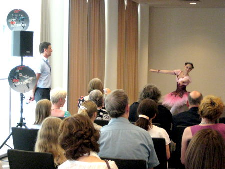 David Nixon, OBE, and the attendees watching Julie Charlet performing an excerpt from Dance of the Sugar-Plum Fairy.