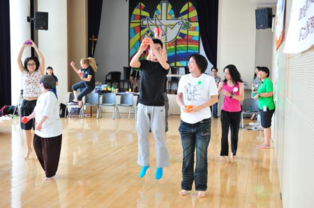 Participants jumping for the joy of dance in the workshops