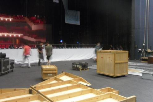 Cargo crates of the Peter Pan set being unpacked on stage