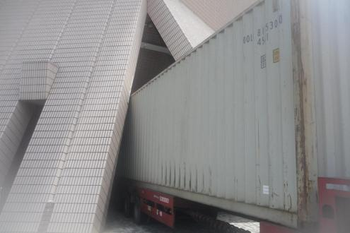 Container truck containing the set and rigging for Peter Pan reversed into the unusually shaped opening at Hong Kong Grand Theatre